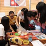 Students introducing Nepalese food to others
